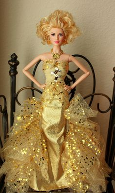 Gracielle is turning on golden glamour by wearing this gown. It's a collectible designed by Robert Best