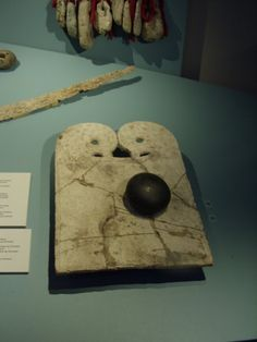 Whalebone plaque and smoothing stone, from the Kulture Historisk Museet in Bergen, Norway - photograph by Erin McGuire - Picasa Web Albums.