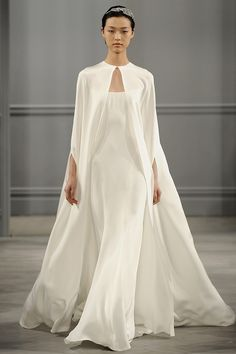 Wear a cape. Because capes are always fun. | 22 New Fashion Rules For Wedding Dresses