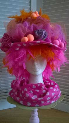 Pink partyhat with underneath a boa wig. Colours are orange and pink. Made  by b9a993828bd