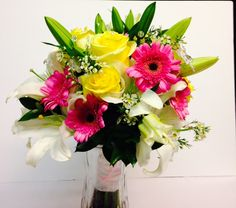 Luscious pink gerbera daisies, white lilies, yellow roses and wax flowers in colorful bridal bouquet. www.bertholdsflowers.com Berthold's Flowers, Elk Grove Village IL
