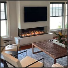 🔥🔥 Installed by August West Fireplace in gorgeous oceanfront home. Thanks to an incredible contractor, their talented carpenters and finish trades people this project was a complete success! Only with heat management technologies can you achieve this Fireplace Tv Wall, Fireplace Remodel, Living Room With Fireplace, Fireplace Design, Home Living Room, Living Room Designs, Corner Fireplaces, Fireplace Ideas, Kitchen Living
