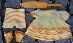 """0048D GULLTOPP (Goldtop) Dress, trousers, socks and hair band. (This doll knitting pattern also fits 17""""-18"""" dolls like Baby born and Chou Chou.) Design: Målfrid Gausel"""