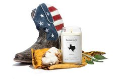 """* Scent includes a hint of leather, a bit of fresh cotton, and a just a touch of sage* Made from all natural soy wax in the USA* Typical burn time is 60-80 hours* Candles weigh 12 oz each """"I light this every time my Texas girls come over. We love it. It smells like home."""" - Allison S, Los Angeles * Hand-poured and shipped within aweek"""