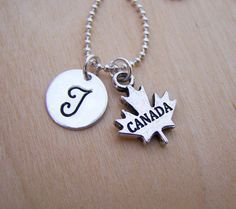 ✦ Mobile Shoppers < swipe > to see all photos ✦  ❀ Gift packaging included with every order! ❀    This necklace is handcrafted featuring a detailed silver Canada charm, a 12mm silver disc charm hand stamped with your initial, and hand-painted with black acrylic paint to enhance the letter. Attached to a 1.5mm, high-quality silver plated ball chain, made to your specified length.    ♥ ♥ ♥ CUSTOMIZE YOUR NECKLACE ♥ ♥ ♥  Add additional initials, charms and  birthstones here…