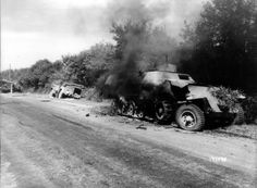 Burning SPW halftrack destroyed by 813rd TD Bn on August 11, 1944 .