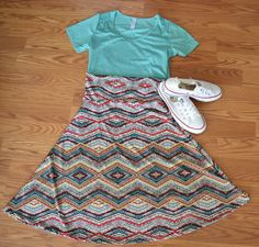 LuLaRoe Azure skirt and Classic Tee outfit inspiration!  Shop these and other LuLaRoe styles at: https://www.facebook.com/groups/lularoemeganmandy/