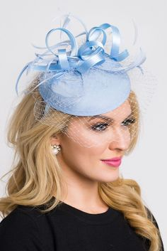 Be the envy of the party in this elegant felt fascinator. The round felt  base 8c5d2000c553