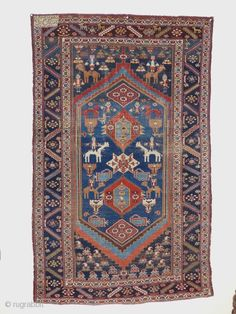 A nomadica Bakhtiari Rug,circa 1900 jh,Beautiful Colours,animals,flowers and other tribal motife. midfield has low pile,original ends and sides,no repair. size; 205x123 cm