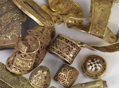 The Staffordshire Hoard is the largest hoard of Anglo-Saxon gold and silver metalwork yet found. It was unearthed in a field near the village of Hammerwich, near Lichfield, in Staffordshire, England, on 5 July 2009. The hoard consists of over 3,500 items.