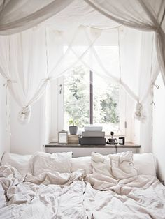 draping and layers :: window sill as shelf, layered sheer drapes, rumpled sheets