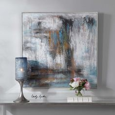 Add modern style to a space with this abstract design. This hand painted canvas showcases ivory, charcoal, and blue tones with mustard and forest green drip accents. Each canvas is stretched over a wooden frame and completed with an antique silver gallery frame. Designed by Carolyn Kinder International.