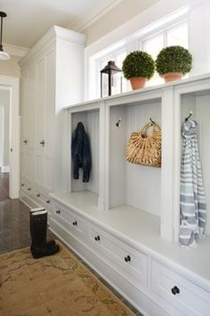 nicely done, long hallway turned mudroom