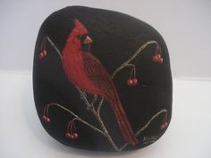 Cardinal hand painted on a rock by wildstonepainter on Etsy