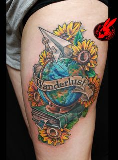 Globe Book Flower Tattoo---not this one but a mix of my own travel objects