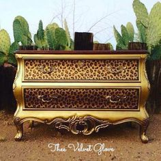 We're wild over this dresser with our Olympic Gold Metallic Paint and leopard spots on the drawer fronts! The artistry is by the talented Thee Velvet Glove.