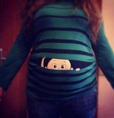 maternity shirts for twins | Baby peeking out shirt... - The Bump