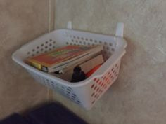 RV and travel trailer storage and organization - hang baskets by the bed with Command hooks