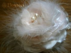 Fabric flower in white satin and white marabou feathers perfect as bridal headpiece or any other bridal adornment, wedding accessory, wedding decoration, bridesmaids or flower girl hair pin accessory... This soft and elegant flower is entirely handmade with high quality bridal white satin, blush pink chiffon, lace and small pieces of marabou feathers nestled in between the fabric petals. The central button is a small high quality pearl and rhinestone flower shaped button of 1 in diameter…