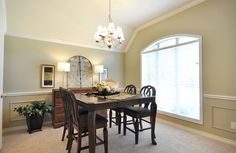 Gray and White Wall Color for Dining Room Decorating with Elegant Rectangle Shaped Black Wood Dining Table on the Gray Carpet that have White Flower Centerpiece Decor complete with the Chairs also Classic Chandelier
