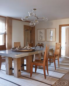 Robert Stilin Interiors - Hamptons Style - custom made concrete and chestnut table ♥