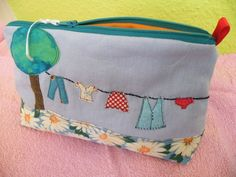 https://flic.kr/p/5PKWXt | washing line finished! | A friend of mine wished a washing line on a cosmetic bag..... Now this cosmetic bag is finished - pew! Especially these cute red pants were a little tricky....