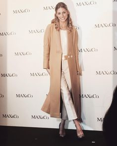 Olivia Palermo in a camel coat, tailored separates and a pair of snakeskin pumps.
