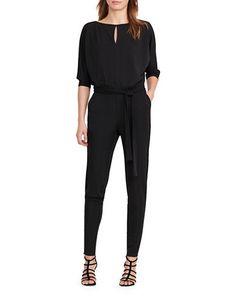 "A bold geometric print adds modern flair to this fluid crepe jumpsuit and the wide-leg style is chic any time of day.<br><ul><li>V-neckline</li><li>Spaghetti straps</li><li>Sleeveless</li><li>Shaping darts at the bust and back waist</li><li>Self-tie waist sash</li><li>Wide-leg silhouette</li><li>Polyester lining</li><li>Rise, about 12""</li>&l..."
