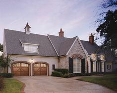 @Clopay Doors | Residential Garage Doors and Entry Doors | Commercial Doors Commercial Doors Reserve Collection Semi-Custom Handcrafted Wood Carriage House Garage Doors Design 6 with Arch 4 Glass