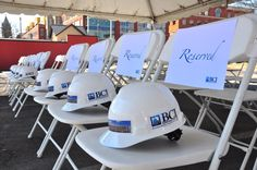 Hard hats on chairs at Saratoga Groundbreaking Ceremony for Woodlawn Avenue Parking Garage in Saratoga Springs, NY