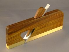 Wooden bodied brass souled plane.