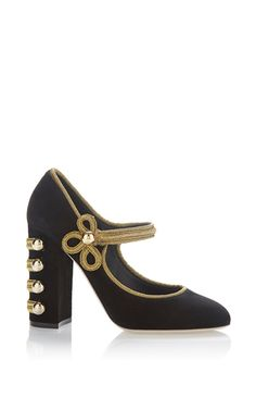 This **Dolce & Gabbana** pump is rendered in suede and features military inspired buckle closures.