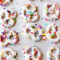 White chocolate pretzels with sprinkles.