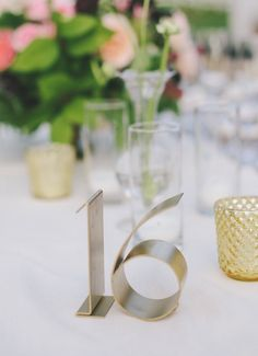 photo: Jake and Necia; Modern wedding reception table number idea;