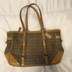 COACH Handbag Authentic Coach Handbag. Has two pockets inside and one zipper pocket. Has a small pocket on the outside. Has a very small stain on the tan color upper border of the purse. Overall the purse is in great condition. Coach Bags