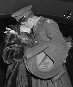 The Christmas cigar waits while a soldiers mouth is otherwise occupied at Grand Central as he prepares to ship out overseas. 1942.