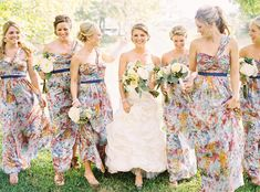 fun, printed bridesmaids dresses  Photography by ryanrayphoto.com, Floral and Event Design by http://razzledazzlejone.wix.com/rd100