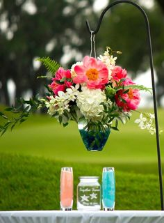 Coral and Turquoise Wedding. Altar flower decor wedding coral peonies white hydrangeas. Coral Turquoise Sand Ceremony. Colleton River Plantation, Bluffton, South Carolina.
