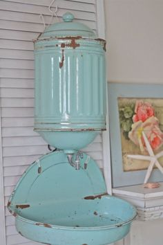 I think that this is a vintage chicken feeder in this awesome aqua color