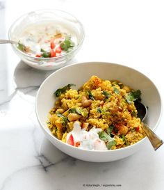Chickpea Cauliflower Rice Biryani. 1 pot 30 Minute Meal with Veggies, Chickpeas, Spices, and Cauliflower Rice. Served with tomato raita. Vegan Gluten-free Soy-free Grain-free Recipe |VeganRicha.com