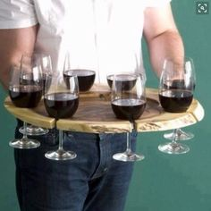Wine server...Just build to fit 8 wine glasses. Add a recessed cutout in the center for an appetizer plate.