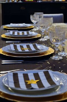 Striking place settings at a gold and black New Year's party!  See more party planning ideas at CatchMyParty.com!