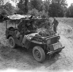 A jeep modified to carry two stretchers seen bringing casualties back to a regimental aid post, during Operation 'Bluecoat', the offensive south-east of Caumont, 30 July 1944.