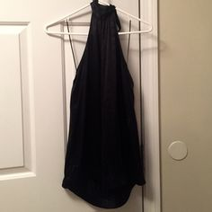 Chic black silk halter top Chic black silk halter top for a girls night out or date night in the city! Flowy throughout but cinched at the waist for a great shape and a cool look for jeans! Express Tops Tank Tops