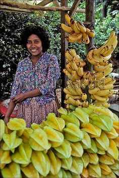 Indonesia, sumatra, woman selling starfruit and bananas