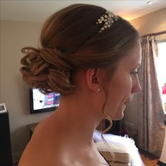 Low central bridal curly hair up - curly bun