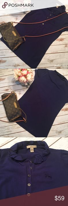 Burberry Brit - Sz XS Navy Ruffle Collar Polo Burberry Brit - Sz XS Navy Ruffle Collar Polo. 100% Authentic and in excellent used condition! Bundle and save 🤑 Burberry Tops Tees - Short Sleeve