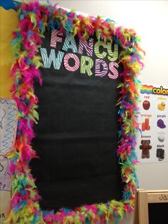 Love the boa as a border! Fancy Nancy can be used to go along with a fancy words wall. Students hear and learn new words every day and having a place for them to bring them back to gets them looking for new words that enhance their vocabulary.