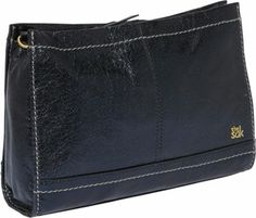 This Sak clutch is made of leather. It is a multi-funtional bag, with convertible shape