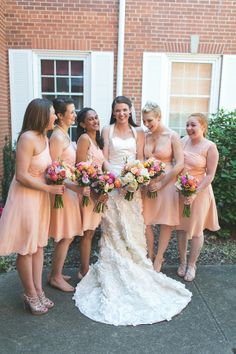 peach bridesmaid dresses and colorful bouquets